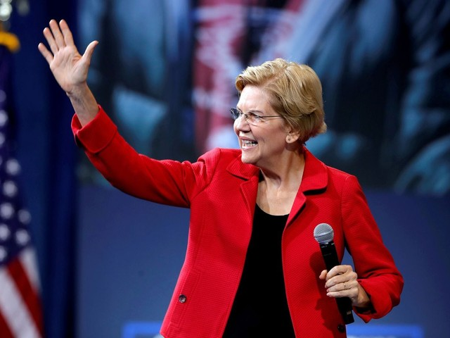 After weeks of criticism, Warren says she will release a plan to pay for Medicare-for-all