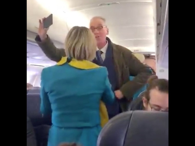 Climate change protester bent on delaying flight gets heckled by fellow passengers while a BBC editor on board points out some serious irony