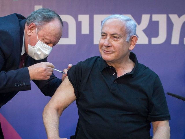 Nearly one-third of Israelis have been vaccinated, and very few of them have gotten sick — a sign of light at the end of the tunnel