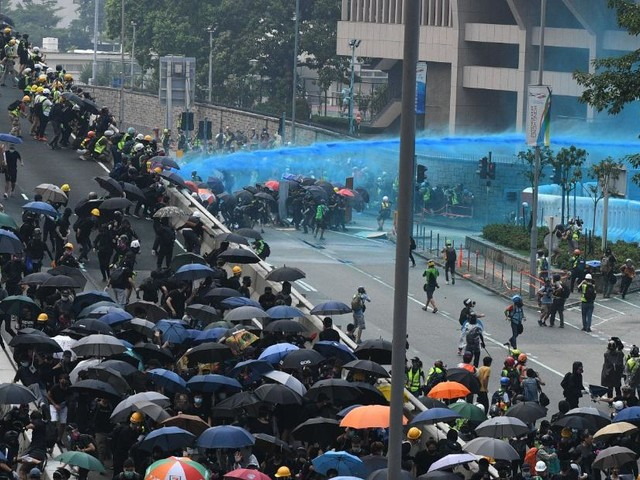 Hong Kong police fire tear gas and water cannon at protesters