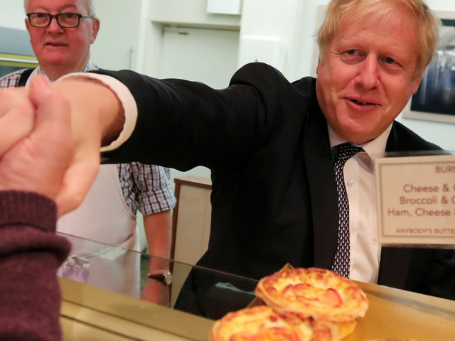 'He hasn't got the balls!': BoJo blames 'crusties' for his no-show at Glastonbury bakery as protesters jeer