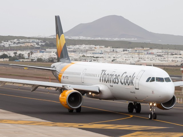 A Thomas Cook flight attendant says she only learned that the company collapsed and she lost her job on Facebook