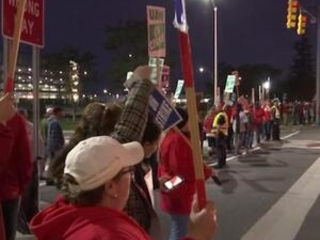 Workers march at GM tech center as strike rolls on