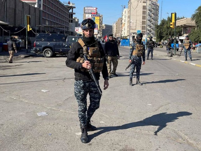 At least 13 killed as twin suicide bombings rock Baghdad