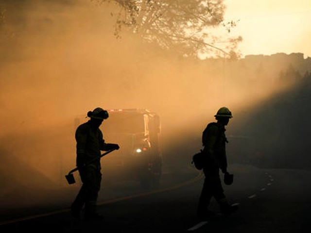 Gusty winds fan California wildfires, force more evacuations