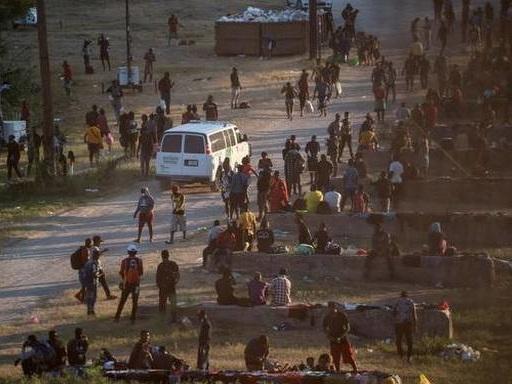Thousands of migrants converge under Texas bridge, posing new challenge for Joe Biden