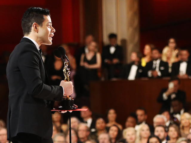 Rami Malek gets treated by paramedics after tumbling off stage with his Oscar in hand