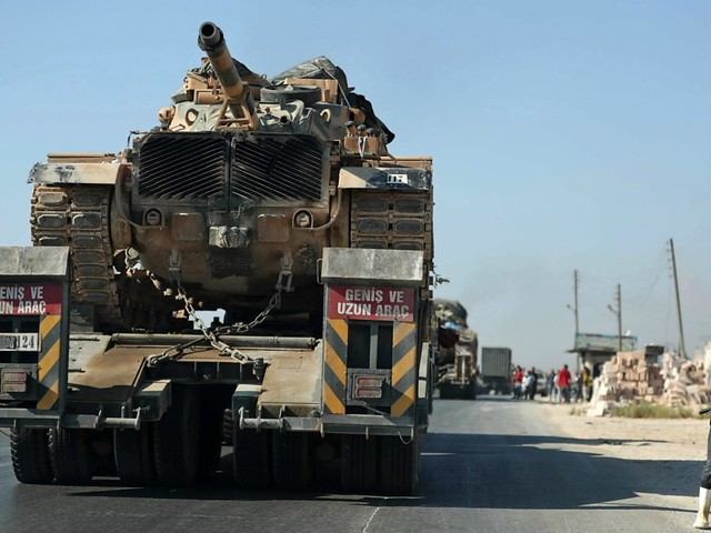 Syrian civil war: Damascus condemns Turkey convoy for Idlib