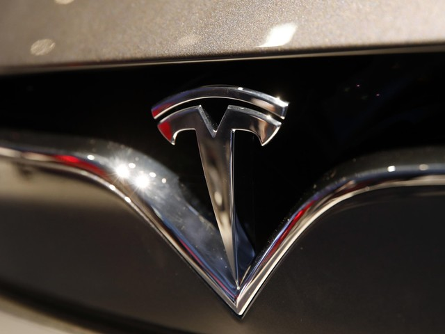 The Latest: Tesla gears up for fully self-driving cars
