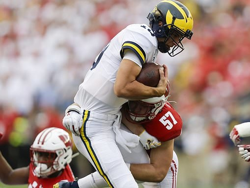 Wisconsin safety is ejected for brutal hit on Michigan quarterback