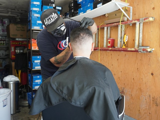 This LA barber started giving $20 haircuts in his garage after COVID-19 closed his shop