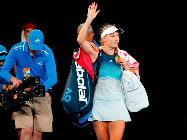 Defending Australian Open champion Caroline Wozniacki all class after early loss to Maria Sharapova