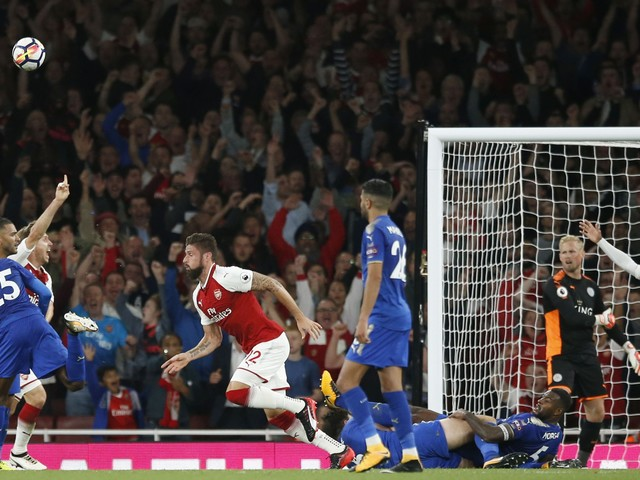 Wenger relieved Giroud stayed, produced opening-day victory