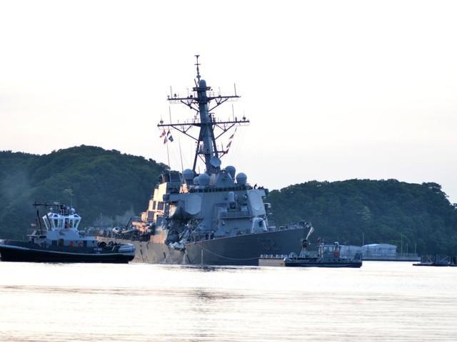 Crippled US destroyer damaged by transport ship