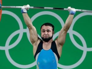 Olympic weightlifting champion charged in doping case
