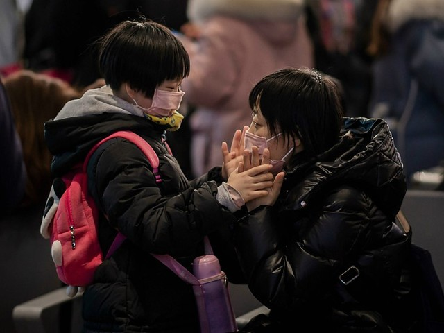 Chinese New Year subdued as virus outbreak spreads