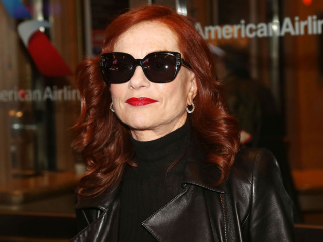 Isabelle Huppert hits New York 'just long enough to shop'