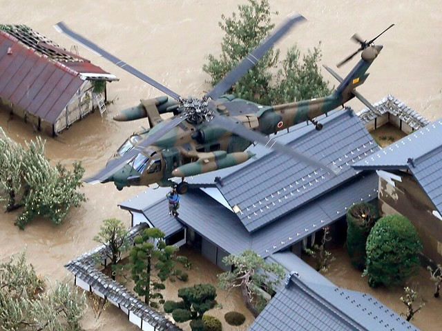 Elderly Japan woman rescued from Typhoon Hagibis dies after falling from helicopter; storm kills at least 33