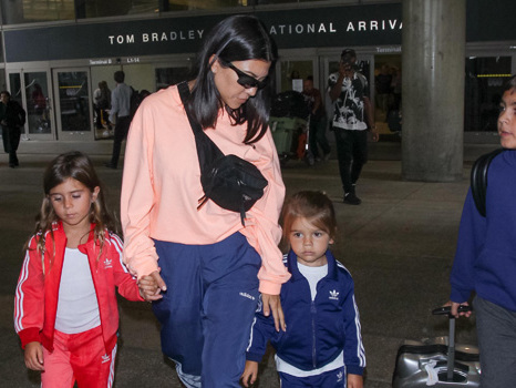 Kourtney Kardashian Claps Back At Fans Who Claim She Doesn't Allow Her Kids To Eat Candy