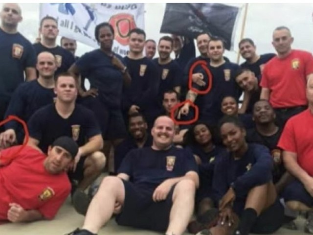 'White power' symbol or circle game? Fire department investigating after pic shows recruits flashing 'OK' sign
