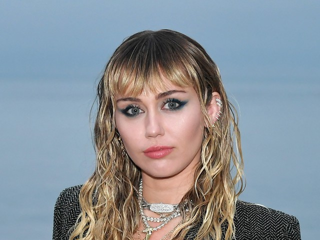 Miley Cyrus Adds A Neck Tattoo To Her Ever-Growing Collection