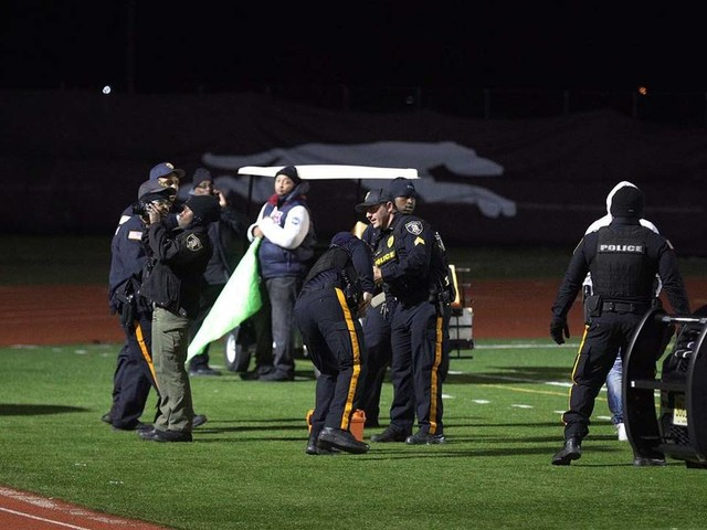 Alleged gunman among 5 charged in high school football game shooting