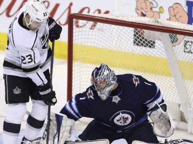 Kings earn a point but lose to Jets in overtime