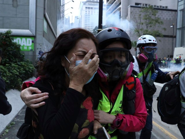 Hong Kong police tear gas rally after protesters attack plainclothes agents