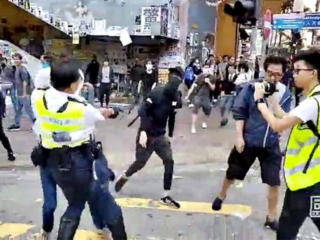 Hong Kong police apparently shoot protester in video posted to Facebook