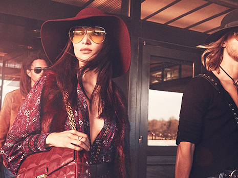 Bella Hadid Channels A '70s Rock Star In Floral Dress & Oversized Sunglasses For New Michael Kors Campaign