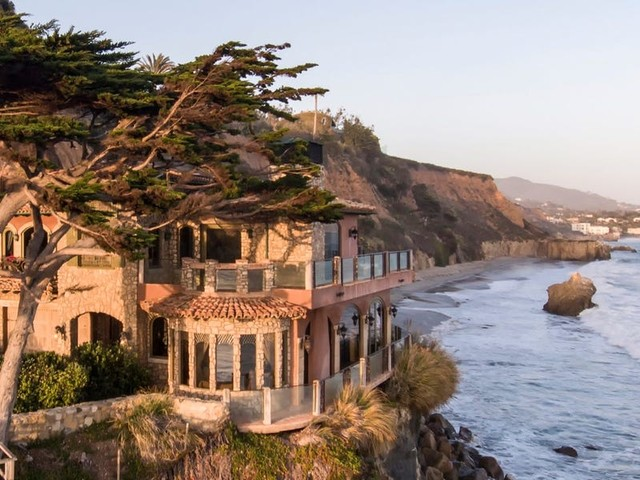 The billionaire CEO of Paycom just paid $26.5 million for a beachfront Malibu mansion that took 12 years to build and blends into the rocks. Take a look inside.