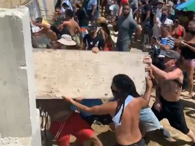 Viral video shows protesters dismantling developer's efforts to build on protected turtle sanctuary, beach