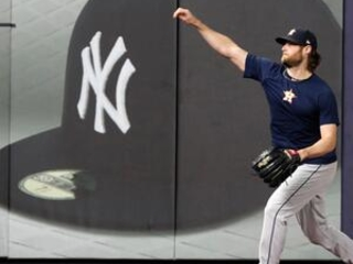 AP source: Yanks land ace Cole on record $324M, 9-year deal