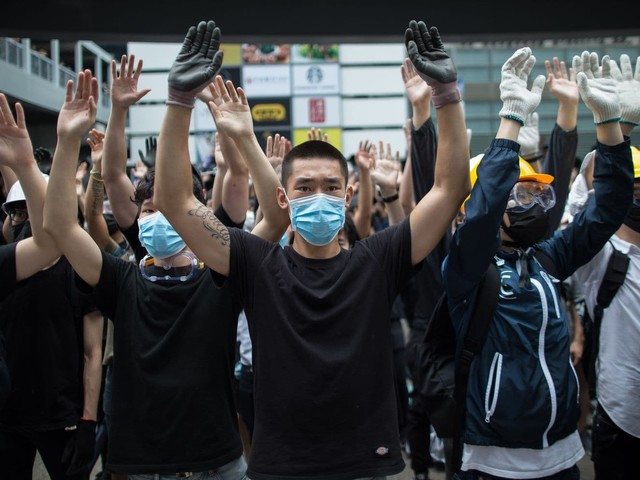 Hong Kong postpones debate on China extradition bill after protesters storm the streets