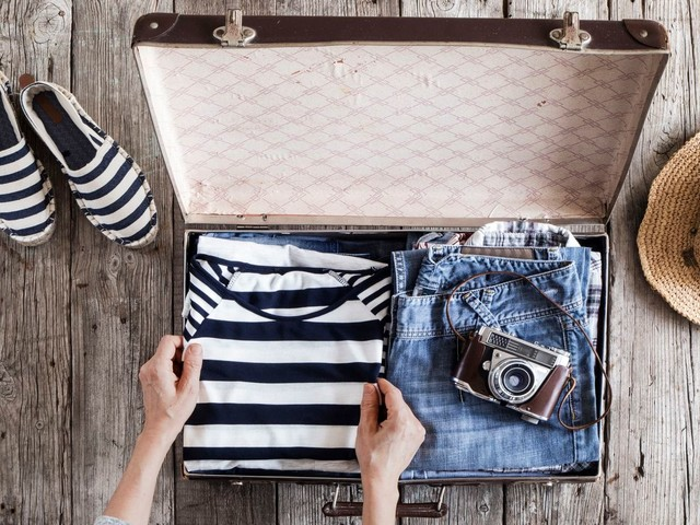 Leave the suitcase at home. Here's why you should just take a carry-on, and how to pack it.