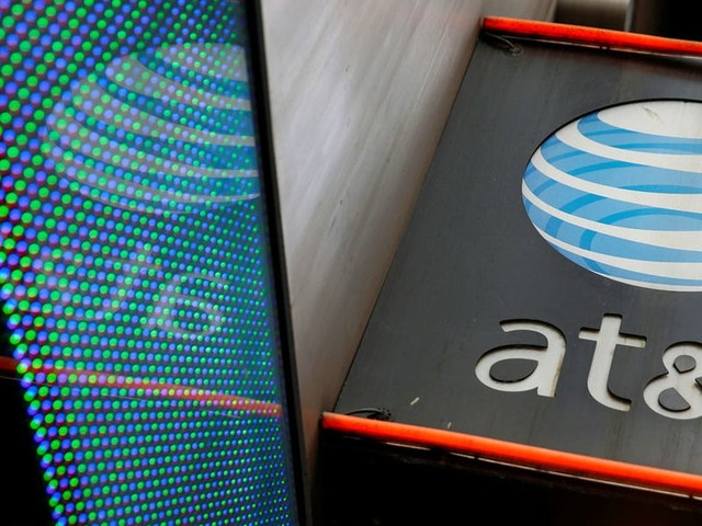 AT&T climbs after releasing a 3-year plan to meet activist firm Elliott Management's goals (T)