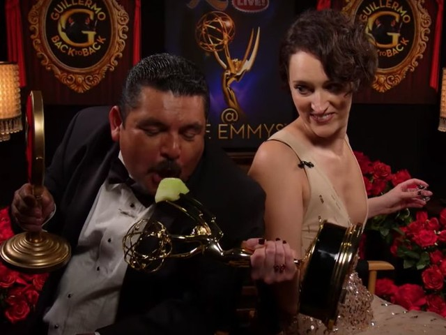 Phoebe Waller-Bridge cheerfully feeds Guillermo fruit using her shiny new Emmy