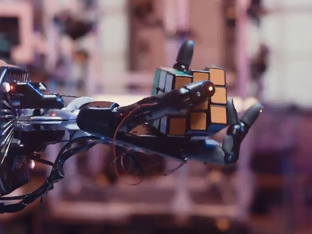 If a robotic hand solves a Rubik's Cube, does it prove something?