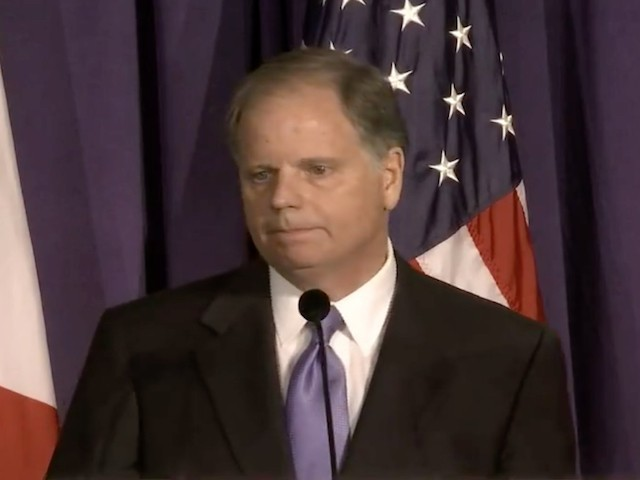 Doug Jones Takes Shot at Roy Moore: I Use Guns for Hunting, 'Not Prancing Around on Stage in a Cowboy Suit'
