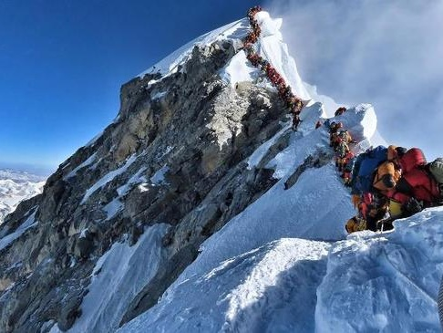 "Shocking Photo Shows Mt. Everest ""Death Zone"" Traffic Jam As Climber Fatalities Rise"