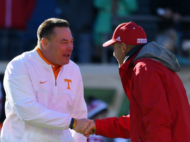 Tennessee's and Nebraska's hot-seat coaches are kicking off at the same time, on the road, as underdogs to teams they're supposed to always beat