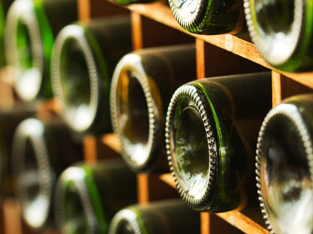The Real Reason The Bottom Of Wine Bottles Have An Indentation