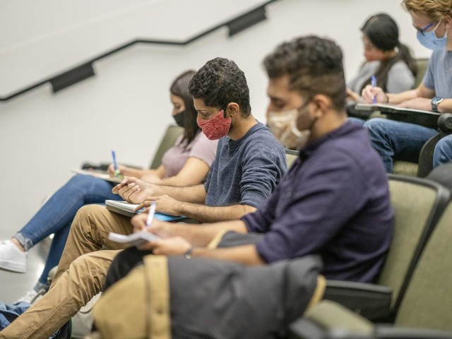 Colleges scramble to incorporate new CDC guidance on masking into their plans
