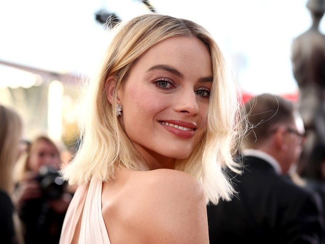 Why Margot Robbie Is The Ultimate Summer Beauty Muse