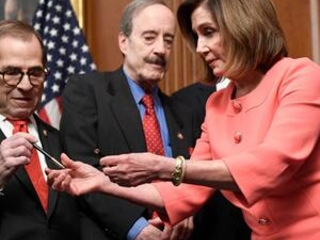 Nancy Pelosi hands out impeachment pens, a signing tradition