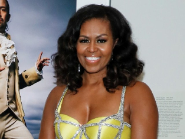 Michelle Obama dazzles in yellow gown to present Lin-Manuel Miranda with award