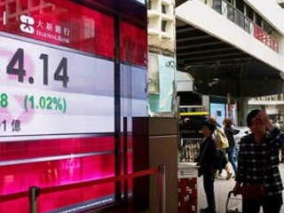 World stocks mixed as US, China move toward deal