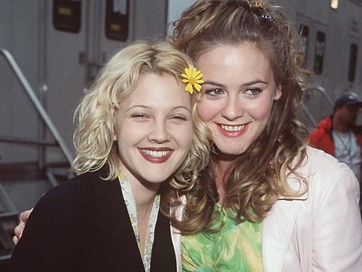 Drew Barrymore, 46, and Alicia Silverstone, 44, are seen arm-in-arm from an event in 1998