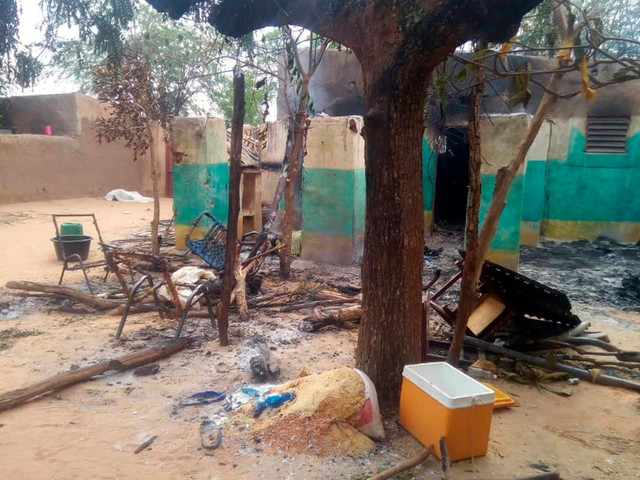 Men dressed as traditional hunters slaughter over 100 people in Mali village