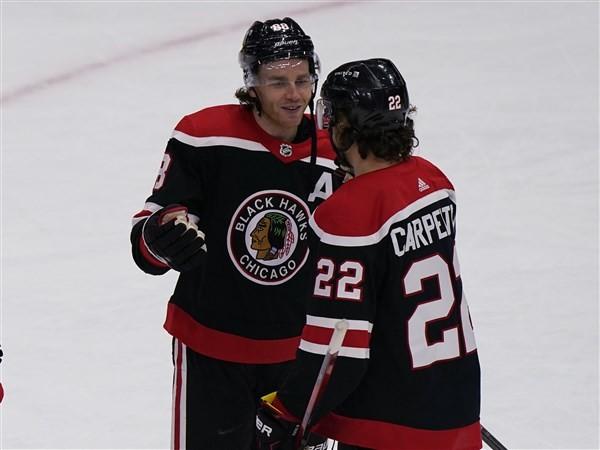Kane scores 400th goal as Blackhawks beat Red Wings